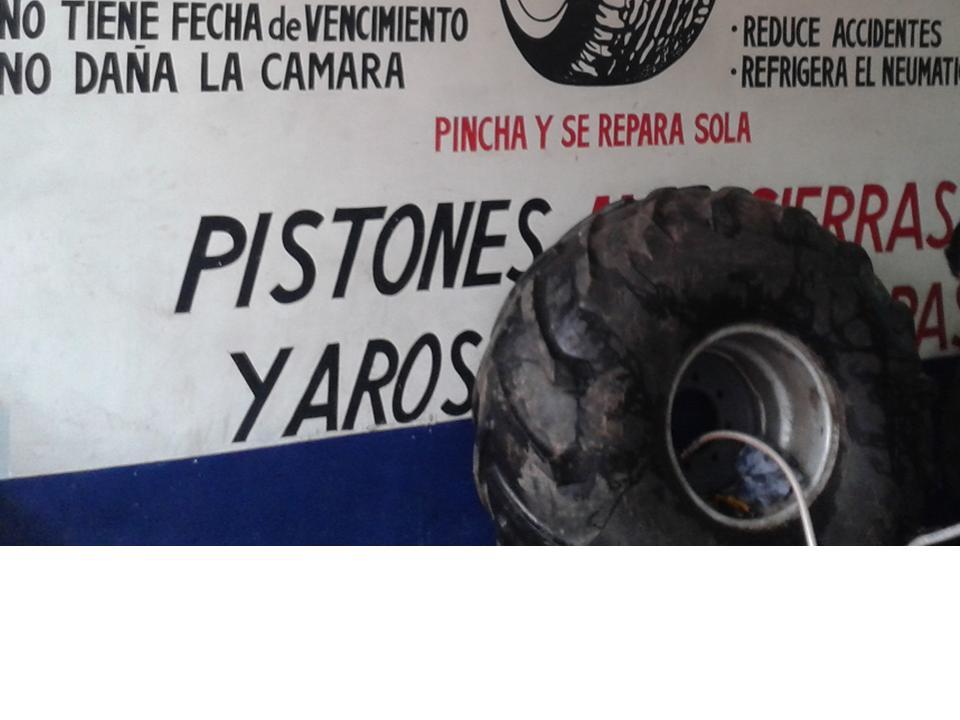 "Rueda de tractor ( con agua) pinchada, reparada con Seal-O-Matic ""hydro"""